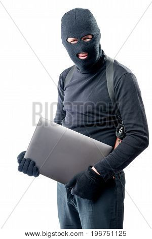 Thief In A Balaclava With A Laptop On A White Background