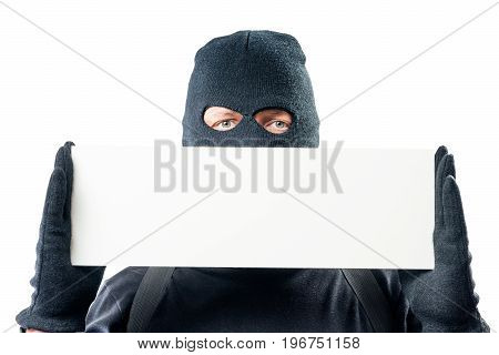 Close-up Blank For Inscriptions And A Portrait Of A Criminal In A Balaclava