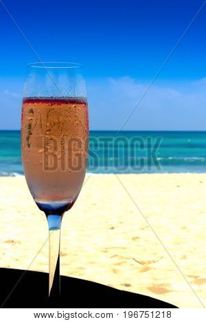 The pleasure of drinking an exquisite champagne glass watching the sea
