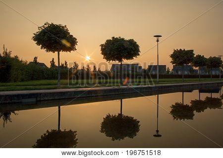 sunset on a riverside promenade in Viersen poster