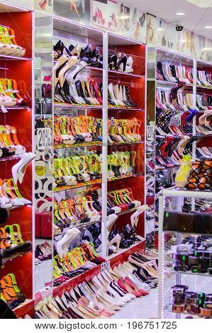 Rows of beautiful elegant colored women's shoes on store shelves
