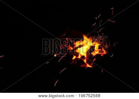 Hot sparking live-coals burning in a barbecue