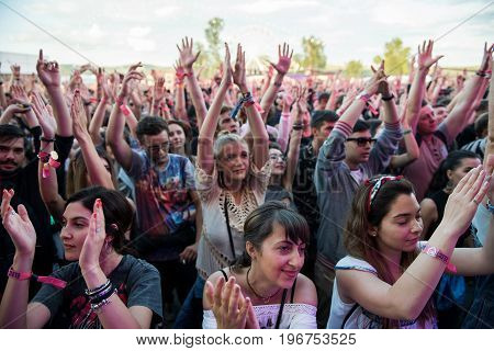 Crowd Of Cheering People Enjoying A Live Concert