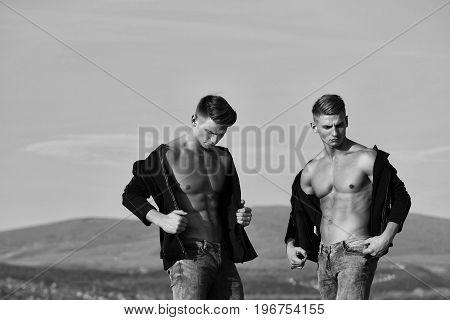 Bodybuilders Or Twins Men On Sky