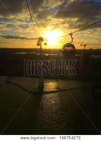 View of a sunset from a cable car in London