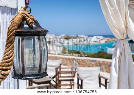Old lantern decoration with white curtain on a Greek cycladic island, Greece