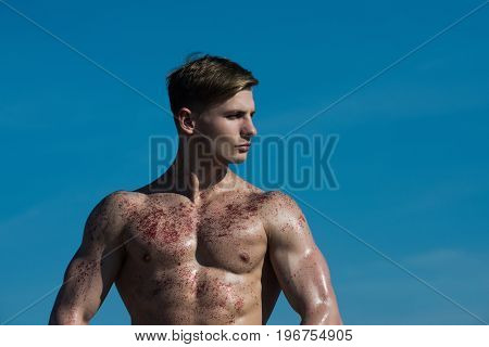 Man with muscular wet body. Adam with glitter on bare chest. Athletic bodybuilder pose as hercules. Sport and workout. Gladiator or atlant.