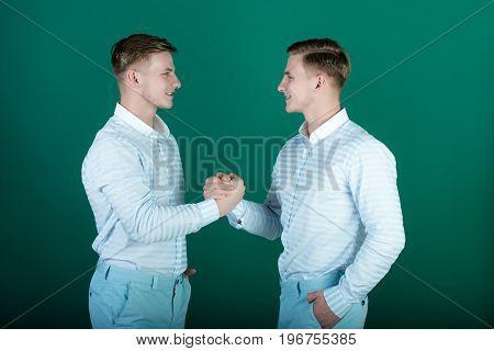 Happy Men Shaking Hands