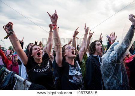 Headbanging Crowd In The First Row At A Hardcore Concert