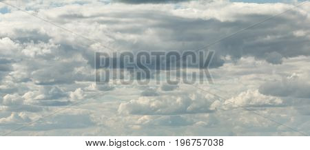 Dramatic clouds on blue sky in Sunny summer day