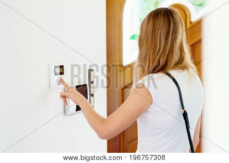Young Woman Entering Authorization Code