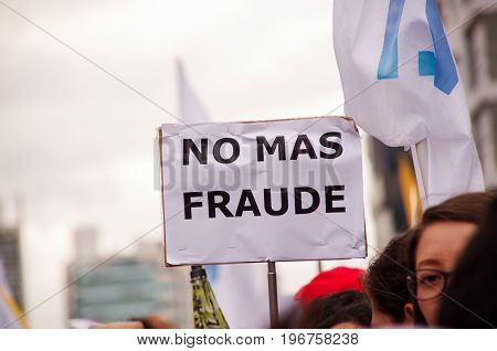 Quito, Ecuador - April 7, 2016: Crowd of unidentified people with banners rejecting the fraud and supporting the presidential candidate Guillermo Lasso, and journalists during anti government protests in Shyris Avenue.