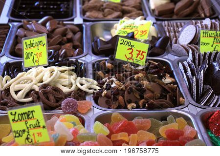 Chocolates and candy on display on a confectioner's market stall (tags: prices and product information in Dutch)