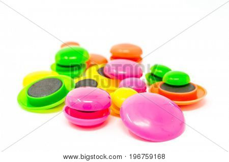 colored round magnets isolated on white background