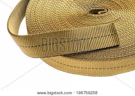 nylon tubular webbing for climbing, mountaineering, industrial work, and rescue, a roll isolated on white