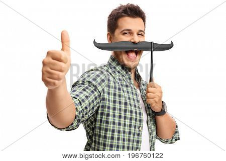 Guy with fake moustache making a thumb up gesture isolated on white background