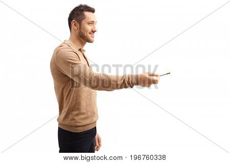 Profile shot of a guy offering a cigarette isolated on white background