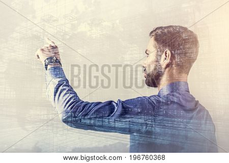 Businessman pointing his finger, thinking about future, planning business strategy. Successful leader, double exposure.