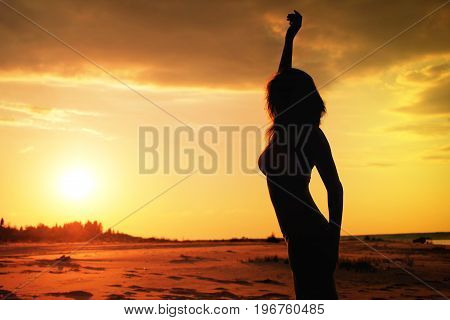 Silhouette of women at the sky sunset background
