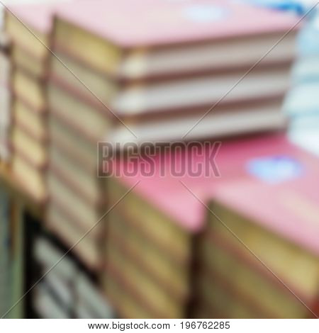 Abstract blurred of stops of books, textbooks or fiction in book store or in library. Education, school, study, reading fiction concept. For abstract background