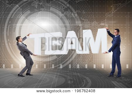 Businessmen holding word team in teamwork concept