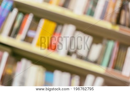 Abstract diagonal rows of different colorful books lying on bookshelfs in the urban bookshop, vintage picture