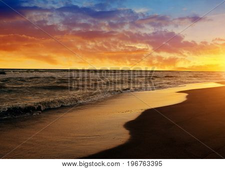 Colorful sunset sky above the sea. Nature background.