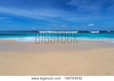 Bali beach with blue waves and white sand
