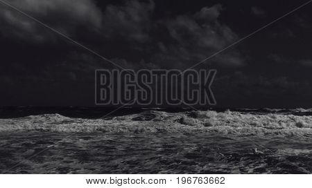 ocean view at night, waves and sea foam
