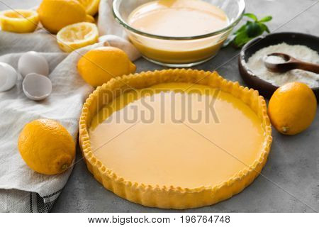 Uncooked lemon pie and ingredients on table