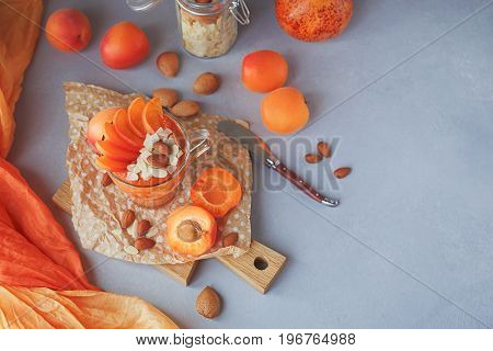 Fresh apricot puree or smoothie with almond on light rustic background. Healthy food concept