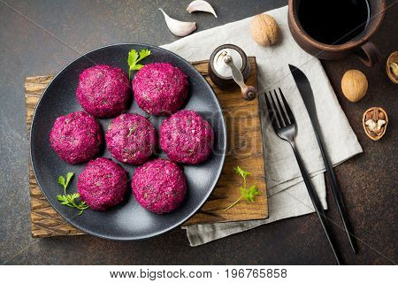 Snack of beet cabbage walnut and cilantro. Traditional Georgian dish Pkhali. Selective focus.Top view. Copy space.