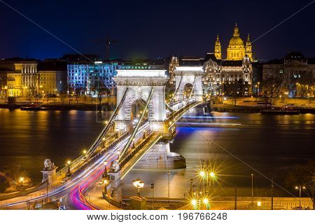 BUDAPEST, HUNGARY - FEBRUARY 22, 2016: Beautiful night Budapest, the Chain bridge across the Danube river in lights and starry sky, cityscape suitable for cover or desktop background