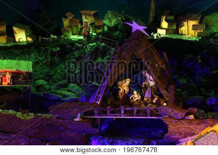 Christmas nativity scene with figurines including Jesus, Mary, Joseph, and sheeps