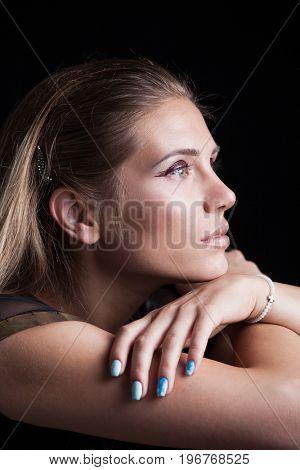 beauty portrait of blonde girl with wet eye shadow profile long hair studio shot