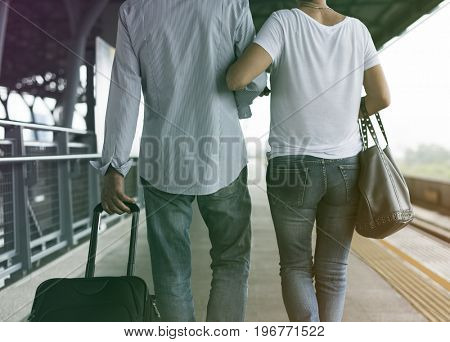 Senior adult couple with traveling luggage at train station