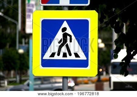 Photo of road sign pedestrian crossing on street