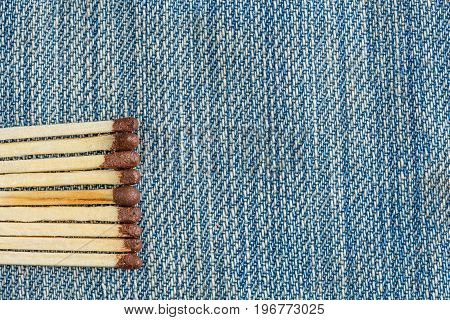 The Matches Are Laid Out In A Row On Denim