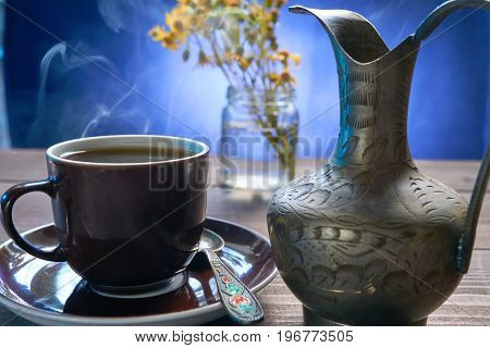 Small Cup Of Fresh Coffee With Jug