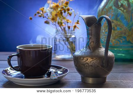 Small Cup Of Hot Fresh Coffee With Silver Jug