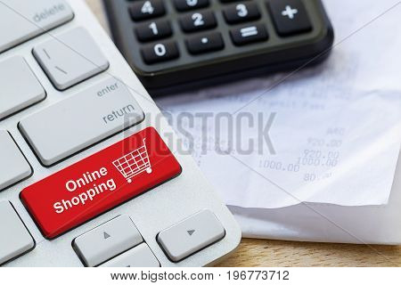 Retail Online Shopping Cart Icon Button On A Keyboard, Calculator And Receipt On Table