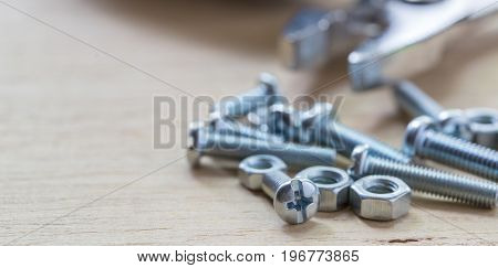 Bolts And Nuts On The Wooden Table