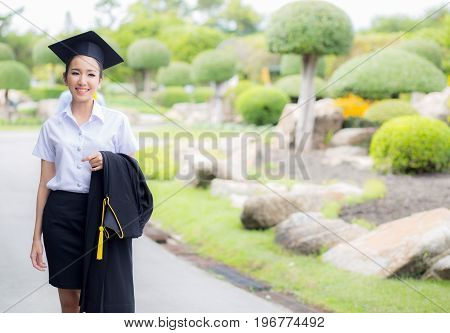 Women Is A Graduate Smiling For The Camera With Happy Successful Of Education