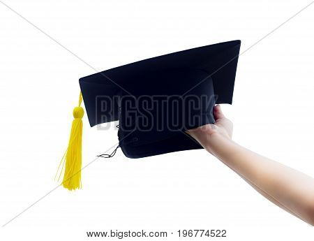 Hand Holding Graduation Hats On Background Of Blue Sky.