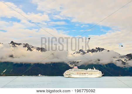 A view of a large cruise ship floating in Resurrection bay in Sward Alaska