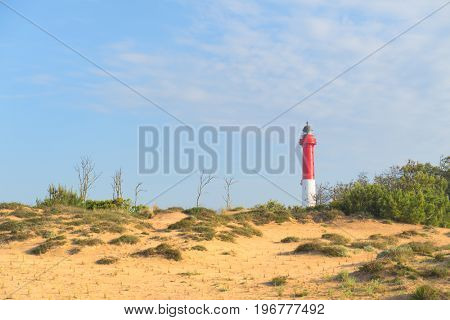 Lighthouse red and white at the French west beach