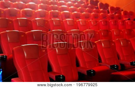 Row of red cinema seats in close up