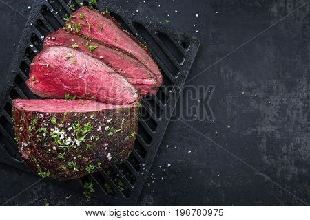 Barbecue wagyu point steak sliced as close-up on a grillage with copy space