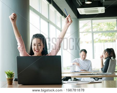 Cheering happy business people