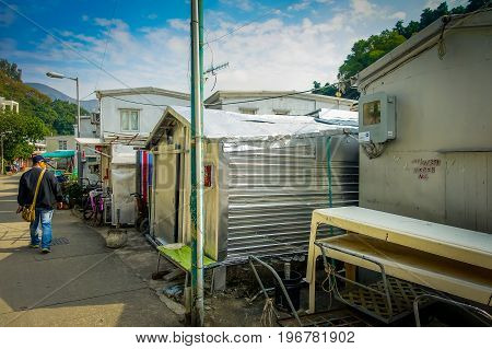 HONG KONG, CHINA - JANUARY 26, 2017: Metallic buildings used as home in old fishermen village Tai O with rustic houses in Hong Kong.
